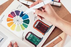 Training on drawing markers in sketchbook, color circle, women`s royalty free stock photos