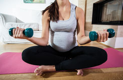 Training with dumb-bells during pregnancy Stock Images