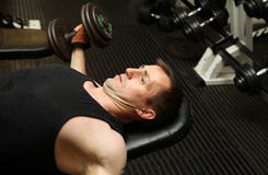 Training dumbbbells gym pecks Royalty Free Stock Photo