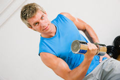 Training with dumbbells Royalty Free Stock Photo