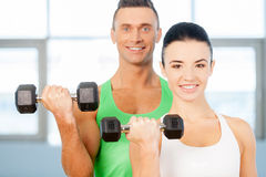 Training with dumbbells. Royalty Free Stock Photography