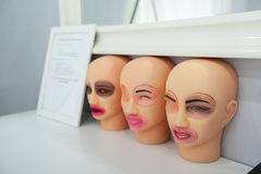 Training dummies permanent make-up, study and skill Stock Images