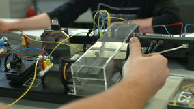 Training electricians on devises in servise. Center stock footage