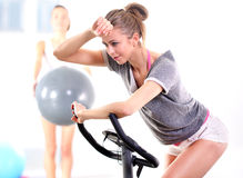 Training on exercise bike Royalty Free Stock Photography