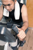 Training on exercise bike Stock Image
