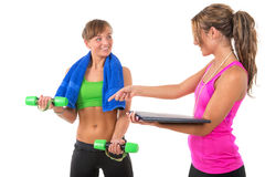 Training by female personal trainer. Young women is training muscles by female personal trainer Royalty Free Stock Images