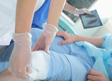 Training in first aid at knee injury Royalty Free Stock Photography
