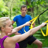 Training with fitness straps outdoors. Royalty Free Stock Images