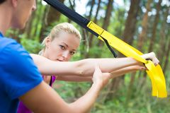 Training with fitness straps outdoors. Stock Image