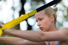 Training with fitness straps outdoors. Royalty Free Stock Photo