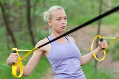 Training with fitness straps outdoors. Stock Images