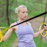 Training with fitness straps outdoors. Stock Photography