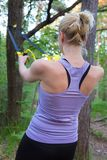 Training with fitness straps outdoors. Royalty Free Stock Photography