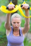 Training with fitness straps outdoors. Royalty Free Stock Photos