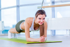 Training fitness woman doing plank core exercise working out for back spine and posture Concept pilates sport.  stock image