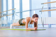 Training fitness woman doing plank core exercise working out for back spine and posture Concept pilates sport Royalty Free Stock Photos