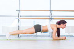 Training fitness woman doing plank core exercise working out for back spine and posture Concept pilates sport.  stock images