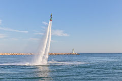 Training flyboard on the dock marina in Vilamoura, Portugal. Royalty Free Stock Photography