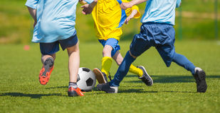 Training and football match between youth soccer teams. Young boys playing soccer game. Hard competition between players running and kicking soccer ball. Final Stock Photography