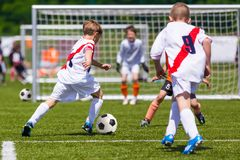 Training and football match between youth teams. Young boys play stock photography