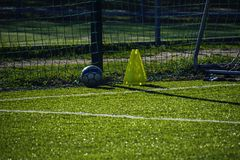 Training football pitch with artificial green grass and training Royalty Free Stock Photo