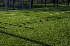 Training football pitch with artificial green grass and training Stock Images