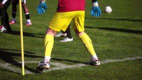 Training football players, feet close-up stock video footage