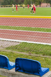 Training of football players watched from a grandstand. Royalty Free Stock Photo