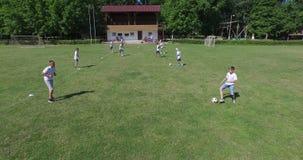 Training at football school, 4k (Aerial) stock video footage