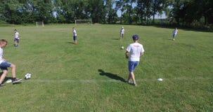 Training at football school, 4k (Aerial) stock footage