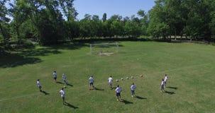 Training at football school, 4k (Aerial) stock video