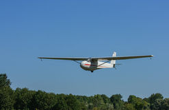 Training Glider. MANOTICK, CANADA – AUGUST 19: A special glider, used to train pilots, landing at Rideau Valley Soaring on August 19, 2012 in Manotick, Ontario Stock Photos