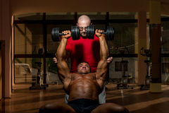 Training in gym where partner gives encouragement Stock Photos