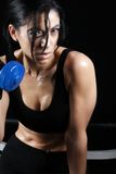 Training hard. Pretty girl sweating while working out royalty free stock photography