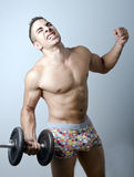 Training hard unsucess. A young man training hard in underpants Royalty Free Stock Photography