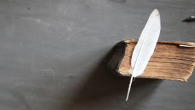 Training idea. Feather pen and old book on blackboard. Vintage composition. Training concept stock video