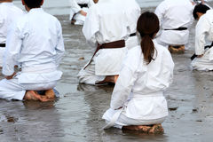 Training of Karate at the beach stock photo
