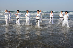Training of Karate at the beach of midwinter, Japan Stock Photo