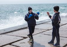 Training karate on the stone coast Stock Images