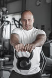 Training with kettlebell in gym Royalty Free Stock Image
