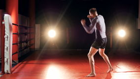 The training of the kickboxer without a partner. Shadow boxing. stock footage