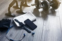 Training kit with phone and headphones. Accessories and fitness equipment for fitness royalty free stock photos