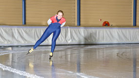 Training lap. Speed skater in the corner of an ice rink during a trainings lap Stock Image