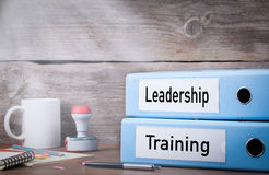 Training and Leadership. Two binders on desk in the office. Business background Stock Photo