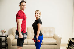 Training and lifting weights together Stock Photography