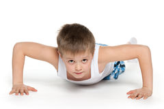 Training of a little athletic boy Stock Image