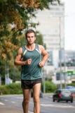 Training - man running in street Stock Photos