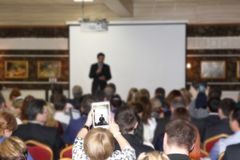 Training many people. In a huge hall a large number of people are trained, a seminar on new types of business Stock Photos