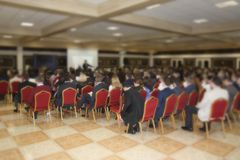 Training many people. In a huge hall a large number of people are trained, a seminar on new types of business Royalty Free Stock Image