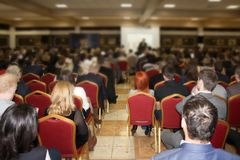 Training many people. In a huge hall a large number of people are trained, a seminar on new types of business Stock Images